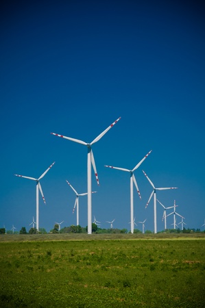 Wind turbine farm on rural terrain photo