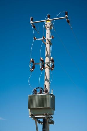 isolators: electric pylon with isolators on blue sky background