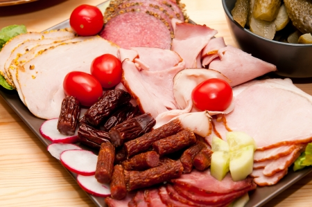 platter of cold cuts and sausages with ham and tomatoes Stock Photo