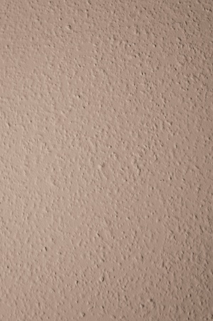 brown structural painted wallpaper on the wall photo