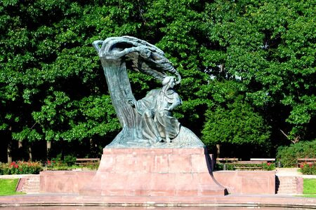 chopin heritage: Chopin statue in autumn at Royal Baths Park (Lazienki Park) in Warsaw, Poland