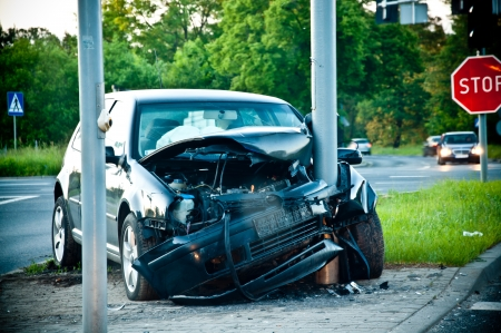 wrecked car after hitting a lamp post Stock Photo