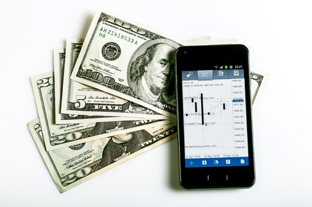 forex trading by mobile phone and money on white background Stock Photo