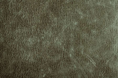 dark grunge scratched leather to use as background photo