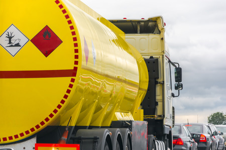 yellow fuel tank standing in a traffic jam