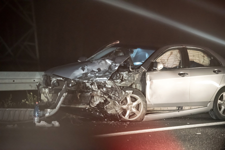 crashed car in accident by night