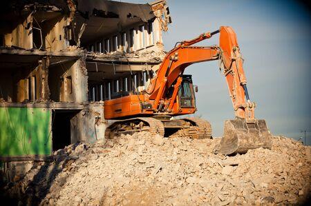 digger: orange big digger destroys building Stock Photo