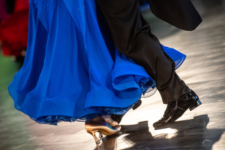 Dancing shoes feet and legs of female and male couple ballroom Stock Photo