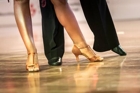 legs of a couple who dance in competition Stock Photo