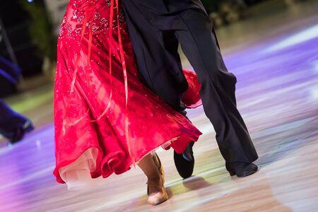 couple dancing standard dance on the dancefloor Фото со стока