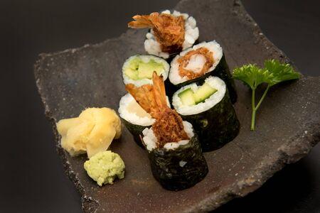Sushi maki rolls with salmon, avocado and prawns