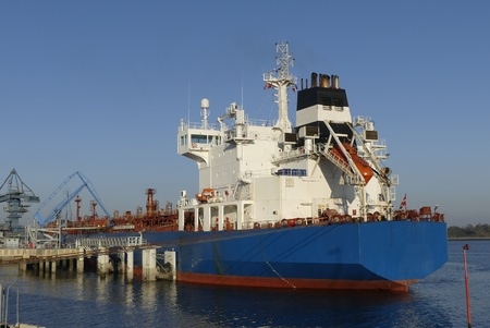 Products Tanker in operations at the Oil Terminal. Stock Photo