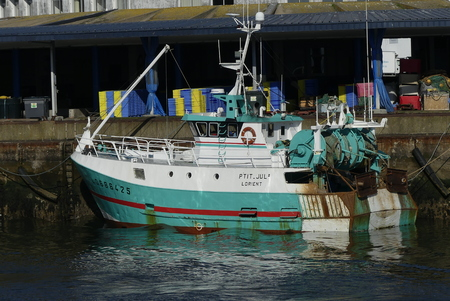 Lorient, France . February 17, 2017: White and Turquoise Fishing boat alongside the pier at the fishing harbor of Lorient, Brittany, France Editorial