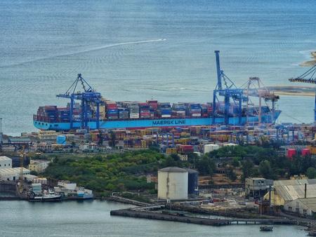 Cargo ship at container handling gantry crane