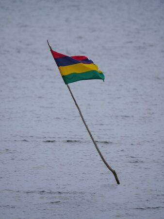 Flag of Mauritius flying over sea