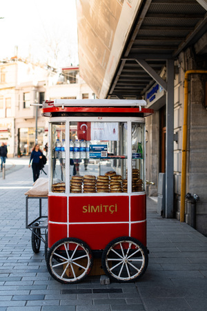editorial - simit cart on street. traditional turkish bagel being sold on street with vintage cart