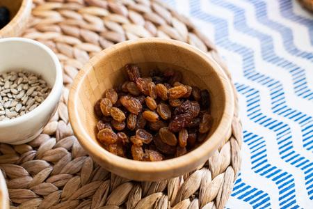 Ingredients for cooking, raisins in a bowl Reklamní fotografie