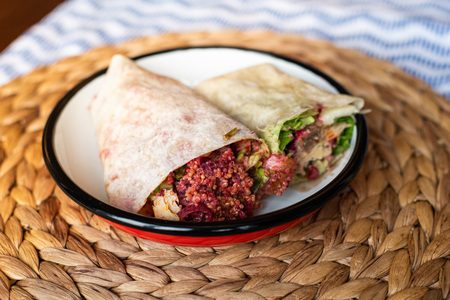 Organic Healthy Wraps with salad, quinoa, grilled chicken, red cabbage, celery and pomegranade, humus, coleslaw, beet, cheese and caramelised onions. Two different kind of shawarma.