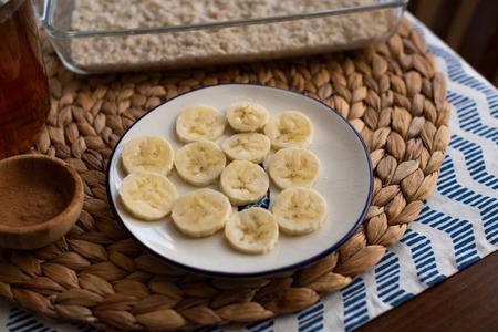 Ingredients for cooking, banana slices on a plate Reklamní fotografie