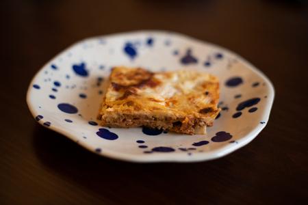 slice of lasagna served on a plate Reklamní fotografie