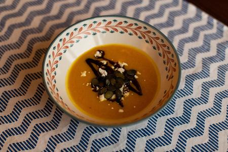 Pumpkin soup with pumpkin seeds, pumpkin oil and cheese