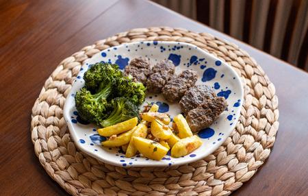 Turkish grilled meatballs AKA Köfte, vegetables on the side.