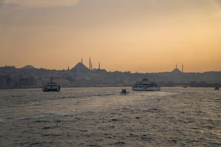 ferries of istanbul, also known as vapur. Marmara sea and Istanbul cityscape in the background. Public transportation in istanbul.