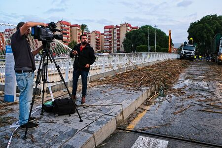 Murcia, Spain, september 13, 2019: tv 7 region of murcia filming rio safe after heavy storms on murcia.