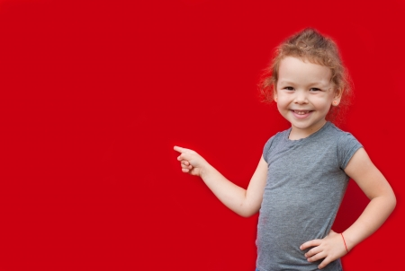 little finger: beautiful youth girl presenting copy space Stock Photo