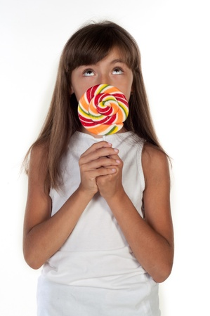 lolly pop: Cute little girl holding big lolly pop isolated in white