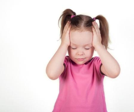 Little girl holding her head