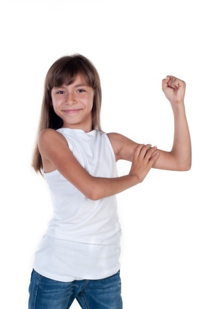 Little girl shows us their biceps isolated in white Stock fotó