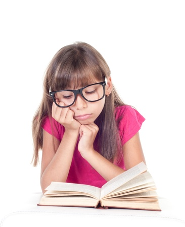 little girl with books wearing glasses, back to school concept, isolated over white Stock Photo - 21526387