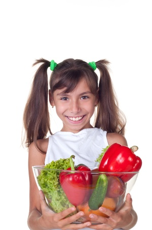 beautiful little girl with vegetables on a white background photo