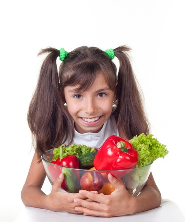beautiful little girl with vegetables on a white background