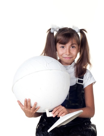 Cute little girl with globe  School portrait Isolated on white photo