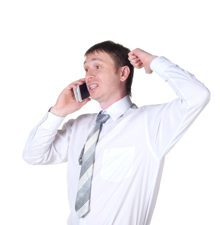 happy successful young business man talking on mobile phone on white background Stock Photo - 21575375