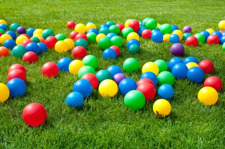 Heap of Colorful Balls on green grass. Birthday party photo