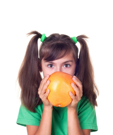 little girl with grapefruit on white background photo