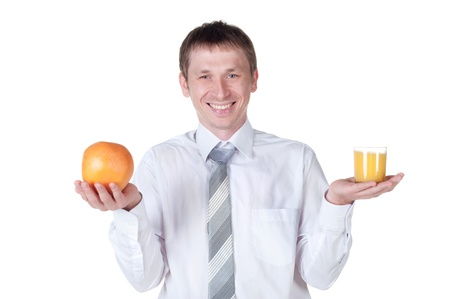 Man showing glass of orange juice and fruit to the camera  Isolated on white Stock Photo