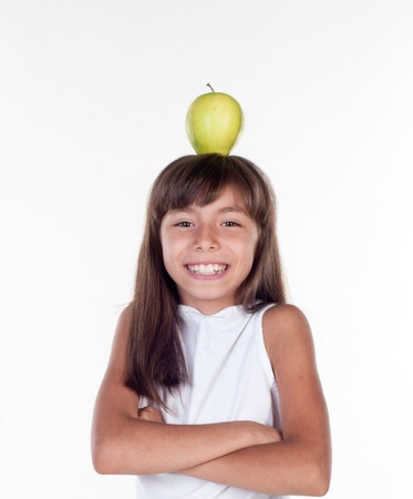 Young girl with apple on head photo