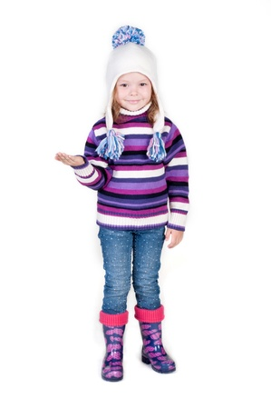 Little girl in winter clothes with empty hand, isolated ower white Stock Photo