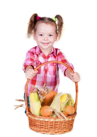 Little girl with basket of vegetables, isolated on white Stock Photo