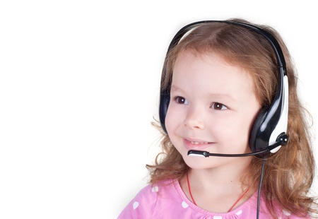 Smiling little girl in headset isolated over white Stock Photo