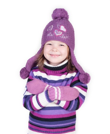 cute little girl in warm clothes on white background photo