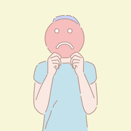 Hand drawn style vector illustration of a man holding an sad emoji sign in front of his face. Concept of bad emotion, pessimistic mood, negative facial expression.