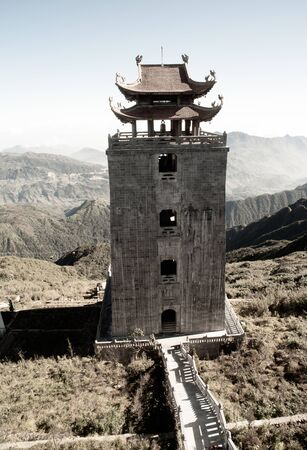 The grand bell tower of Thanh Van Dac Lo Spiritual Landmarks, with scenic misty mountain view as background, at Fansipan peak,Vietnam