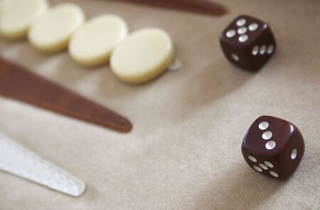taker: A close-up of a backgammon board
