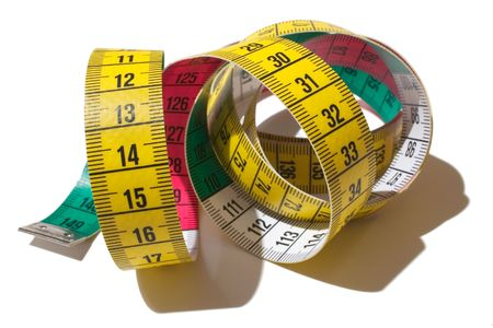 overeating: A tape measure isolated on a white background
