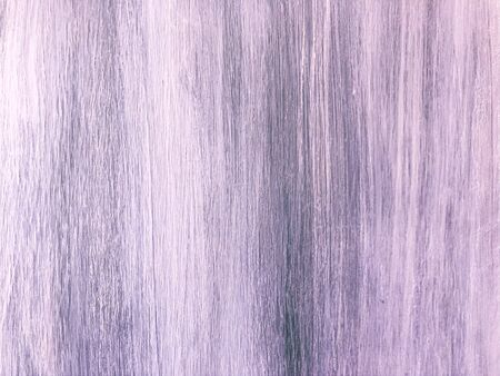 Smooth texture of an old painted wooden door in provence style. White-violet board with scratches. Aged pine-tree surface with a beautiful natural texture. Vertical fibers of a wood. Vintage background